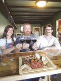 Jessica Krofta, Kris Kincaid, and Lewis Dodson are the proud new owners of Avondale Wine & Cheese