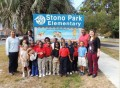 "Stono Park Principal Michelle Simmons and SCDOT'S Safe Routes to School's coordinator Rodney Oldham cut the ribbon officially marking the completion of ""the sidewalk project."""