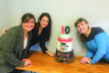 Ashley Bakery's Hayden Campbell, Jenny Vu, and Lani Vandepole helped design, bake, and decorate The West Of 10th Anniversary cake.