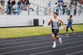 Senior Justin Berry races towards the finish line in as the final leg of the 4x400-meter Relay.