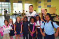 Senior football player Sam Dowd and senior volleyball player Abigail Russell posed with students from Oakland Elementary in their cafeteria before school began.