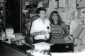 Melvin and his daughter Elaine behind the counter at the store in South Windermere Shopping Center. Elaine - smiling for the camera or maybe at one of her father's jokes. (Photograph courtesy of Elaine Ortner Brabham)