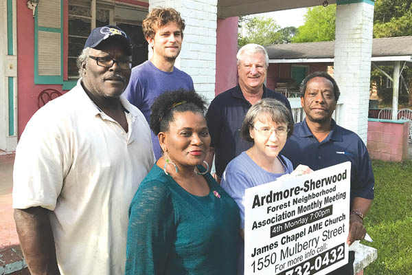 Members and past members of the conjoined Ardmore-Sherwood Forest Neighborhood Association band together on the from steps of The Pink House. Clockwise: Secretary Nancy Snow (holding sign) Past President the Rev. Christian King, her husband Treasurer Kelvin King, Vice President Elliott Wells, Past President Richard Hutchings, and current President Anthony Coaxum