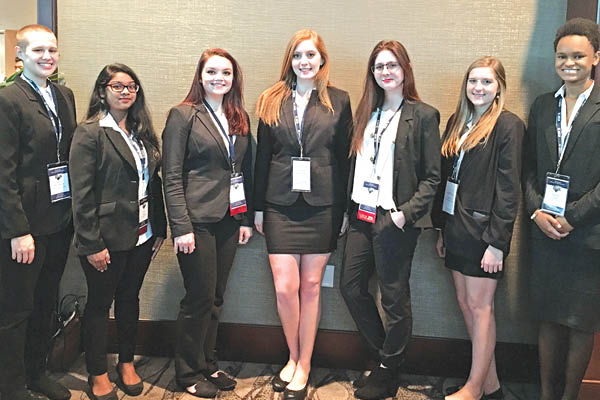 West Ashley students (L-R) Theo McLaughlin, Laniya Correya, Ashley Duke, Olivia Brazelton, Mary Johnson, Alex Ryan, and Jasmine Lloyd pose for a group photo at the South Carolina Health Occupations Students of America State Leadership Conference.