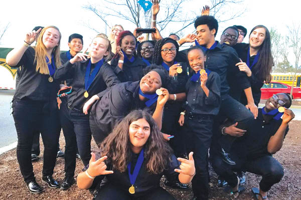 Members of the Indoor Winds celebrate their 1st place win at the SCBDA Winter Ensemble Championships.