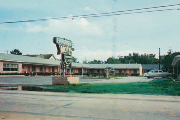 Postcard of The Evergreen Motel. The back of the postcard described the amenities at The Evergreen Motel. (courtesy of Charlie Smith)