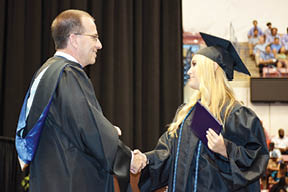 Principal Lee Runyon presents a diploma and offers congratulations to Payton Morelli who will attend Lipscomb University in the fall. Runyon was one of a number of distinguished guests who congratulated members of the Class of 2017. Along with the Admin Team at West Ashley High three City of Charleston councilmen, numerous District 10 Constituent Board members, along with several CCSD school board members were in attendance.