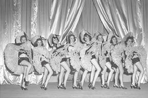 """The ladies demonstrate the """"Can-Can"""" as part of one of Mr. Hester's productions.  (Photograph courtesy of Tom Fowler)"""