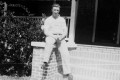 """William Norman James proudly sits on the front stoop of the """"Big House"""".  The home was located on a tract of land that is now at the corner of Markham and Highway 61. James and the adjacent property owners (Tumblestons) sold property to the SCDOT in order that the new road, Markham, could be constructed. Later the property was sold to Texaco for use as a gas station. (Photograph courtesy of Norma Flood Hancock)"""
