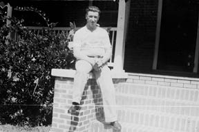 "William Norman James proudly sits on the front stoop of the ""Big House"".  The home was located on a tract of land that is now at the corner of Markham and Highway 61. James and the adjacent property owners (Tumblestons) sold property to the SCDOT in order that the new road, Markham, could be constructed. Later the property was sold to Texaco for use as a gas station. (Photograph courtesy of Norma Flood Hancock)"