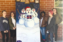 West Ashley High students (L to R) Hanna Hughes, Caitlyn Still, Vincentia Lewis, Dean Rose, and Kimberly McCurdy pose with West Ashley High's giant greeting card before it was transported to James Island County Park for judging. Their greeting card will be on display in Santa's Village until Jan. 1