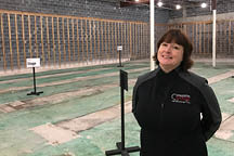 Charleston Stage's associate creative director Mary Beth Clark stands in the space that will be the new home to the local theater company.