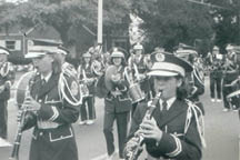 The Bishop England Band marches along Savannah Highway and entertains the crowd with Yuletide carols.  (Photograph courtesy of Peggy Bohne)
